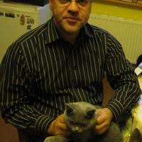 Ojars Lams and his cat Vizbulite