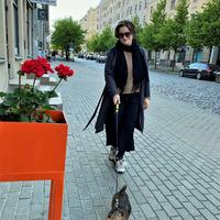 Rita Treija walks with the dog